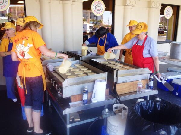 Volunteers from Georgia Baptist Disaster Relief cooking pancakes for Spring Breakers at Beach Reach